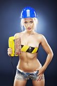 Beautiful Blonde Model With An Electric Sander.