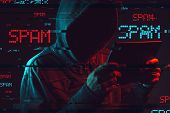 Electronic Spamming  Concept With Faceless Hooded Male Person Using Tablet Computer, Low Key Red And poster