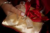 pic of marquise  - Holding wedding bands rings on a little pillow with red and cream bows - JPG