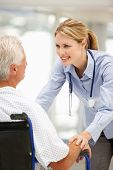 image of older men  - Senior patient with young doctor - JPG