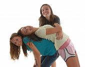 stock photo of bending over backwards  - Three friendly teenage girls having fun - JPG