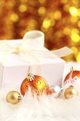 christmas golden ball and gift on a furry background poster