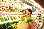 Image of senior woman in groceries department