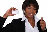 Businesswoman holding up her business card