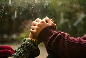 Couple holding hands on a rainy day poster