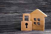 Wooden House With A Padlock. House With A Lock. Security And Safety, Collateral, Loan For A Mortgage poster