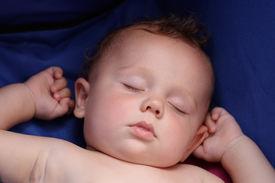 picture of sleeping baby  - sweet little boy sleeps in a stroller - JPG