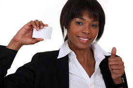 stock photo of self-employment  - Businesswoman holding up her business card - JPG