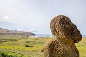 Tukuturi, A Moai, Possibly  One Of The Last Moai Ever Made, With On The Background Ahu Tongariki And poster