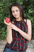 Beautiful Girl Holding Apple