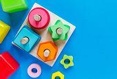 Wooden Kids Toys On Colourful Paper. Educational Toys Blocks. Toys For Kindergarten, Preschool Or Da poster