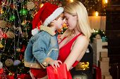 Little Santa Give A Hug To Sister. Brother And Sister Celebrate Christmas Or New Year. Hug And Embra poster