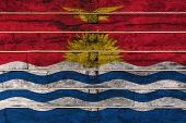 National Flag  Of Kiribati On A Wooden Wall Background. The Concept Of National Pride And A Symbol O poster