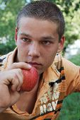 Young Man And Red Apple