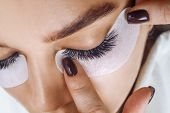 Eyelash Extension Procedure. Woman Eye With Long Blue Eyelashes. Ombre Effect. Close Up, Selective F poster