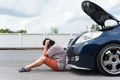 Woman Unhappy And Dismal From Car Engine Problem poster