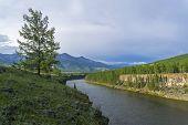 High Steep Banks Of The Oka Sayan River. East Sayan, Buryatia, Siberia, Russia. poster