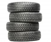 image of four-wheel  - Stack of four wheel new black tyres for winter car driving isolated on white background - JPG