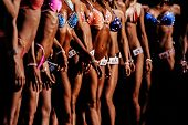 Group Girls Athletes In Bright Bikinis Compete In Fitness Bikini poster