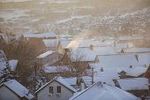 Smoking Chimneys At Roofs With Snow Of Houses Emits Smoke, Smog At Sunrise, Pollutants Enter Atmosph poster