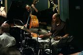 MADISON, NJ - JUNE 16: Drummer Dion Parson (R) and bassist Holt Corcoran (C) of the Steve Turre Quar