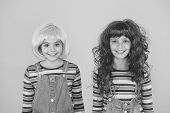 Fashionable And Artistic. Happy Children Wear Fashionable Hair Wigs Yellow Background. Little Girls  poster