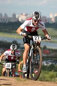 MOSCOW, RUSSIA - JUNE 9: Mirco Widmer (Switzerland) followed by Lukas Loretz (Switzerland) in the European Mountain Bike Cross-Country Championship in Moscow, Russia at June 9, 2012