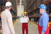 Workerwith Box In Warehouse