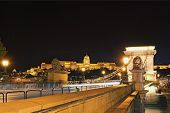 Wide Angle Night Landscape View Of Ancient Chain Bridge. The Buda Castle (royal Palace) In The Backg poster