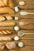 Various Types Of Bakery With Wooden Spoon On Wheat Background