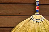 Broom On Wooden Wall