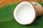 Coconut with banana leaves on wood basket