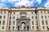 Matthias Gate Of New Royal Palace (novy Kralovsky Palac) And Eu And Czech Flags At Flagpole In Pragu poster