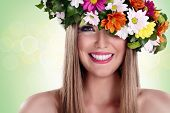 Young beautiful woman with flower wreath and great smile