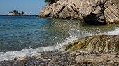 Waves Smashing Against Rocks