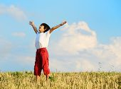 image of time flies  - Kid having happy carefree time on yellow wheat field - JPG