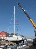 Sail Boat Being Craned Ashore
