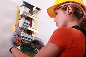 stock photo of fuse-box  - Woman measuring electrical current - JPG
