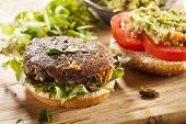 stock photo of sauteed  - Homemade Organic Vegetarian Mushroom Burger with tomato and guacamole - JPG