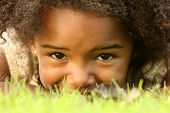 picture of happy kids  - Playful African American Child in a park - JPG
