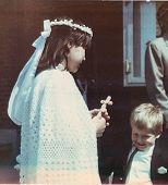 Vintage photo of children - a girl at her first communion with little cousin (early eighties)