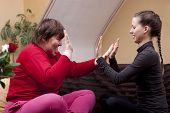 stock photo of physically handicapped  - Two women one of them disabled making rhythm exercises - JPG