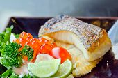 stock photo of cod  - fresh salad with fish egg and Japanese grilled cod fish on dish - JPG