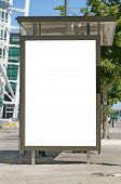 pic of bus-shelter  - An image of a bus stop with a blank bilboard for your advertising situated in front of the turning torso skyscraper in the swedish city of Malmo - JPG