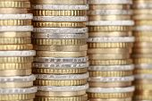 stock photo of coin bank  - A stack of money with Euro coins forming a background - JPG