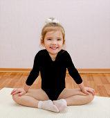 Gymnast Smiling Little Girl Doing Exercises
