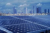 Solar Energy And Cityscape In The City