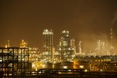 Oil refinery working at night