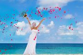 image of bridal veil  - young happy smiling bride on the wedding day on tropical beach and sea background - JPG