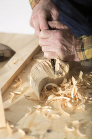 pic of woodcarving  - Old woodcarver work in the workshop - JPG